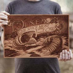 Dune is the greatest science fiction novel ever written.  It has inspired countless artists and writers. Since this novel means so much, SpaceWolf wanted to pay homage by creating this piece and presenting it first.This beautiful limited edition Dune wooden poster has been laser engraved on US sourced cherry hardwood.  Each one is carefully cut, sanded, and oiled by hand then shot with a powerful laser in order to burn in this SpaceWolf ltd. original design.Only 50 of these ...