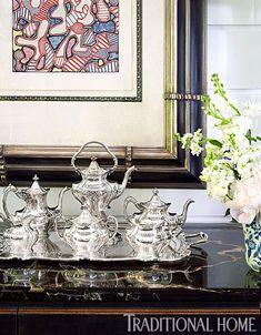 An antique silver tea set sits beneath a painting by Jean Dubuffet. - Photo: Tria Giovan / Design: Kenneth Alpert