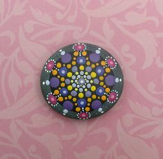 "Mandala Stone (Junior): Hand painted with acrylic and protected with a matt finish, this ""junior"" stone is a touch smaller than my usual stones, at about 2.5 inches diameter. It is one-of-a-kind."