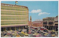 Postcard showing al-Rafidain Bank, Mirjan mosque, and al-Rashid Street, Baghdad, 1950sبطاقة بريدية تظهر بنك الرافدين، جامع مرجان، و شارع الرشيد ، بغداد، الخمسينات