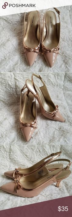 """Bandolino Patent Blush Slingback Sandal Size 7M For sale is a New In Box Bandolino Intimate Women's Shoe in Blush with Rose Gold Bow Trims.?  Two-tone styling lends a mode vibe to the intimate women's shoe. It's designed with a sleek slingback strap and a bow detail on the pointed toe thats sure to get you compliments.?  Details:? Patent Upper? Adjustable ankle buckle? Textured outsole? Heel height: 3""""? Bandolino Shoes Sandals"""