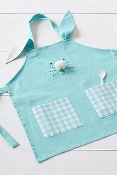 Easter baskets don't have to be limited to candy. These are the best Easter gifts to get your kids this year, from bunny books and toys to personalized keepsakes. Sewing For Kids, Baby Sewing, Diy For Kids, Easter Gifts For Kids, Sewing Aprons, Easter Projects, Fabric Purses, Gifted Kids, Kids Apron