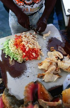 Conch salad, made from conch, pepper, onion, tomato, chilli and citrus juice, is the most popular of the Bahamian dishes and is readily available from the many open-air conch stands.