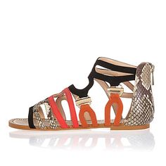 Black and snakeskin print flat sandals 55,00 €
