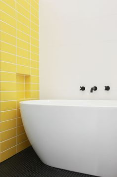 This 70s-inspired townhouse is filled with a rainbow of colours including  these canary yellow