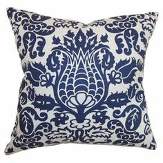 "The perfect accent to your living room, parlor, or master suite, this lovely cotton throw pillow showcases a damask motif for eye-catching appeal. Made in the USA.    Product: PillowConstruction Material: Cotton cover and high-fiber polyester fillColor: Blue and ivoryFeatures:  Insert includedHidden zipper enclosureMade in Boston, Massachusetts Dimensions: 18"" x 18""Cleaning and Care: Spot clean"