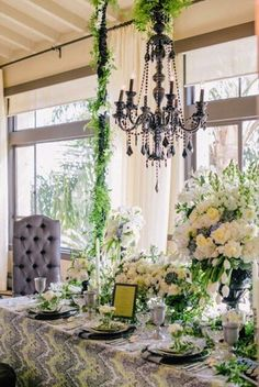 """Hilary Hamer Events and Commerce Flowers collaborated on this gorgeous design, """"Château de Noir"""" for our Luxe Launch LA hosted at Bel-Air Bay Club. The team brought in rentals from Revelry Event Design and Classic Party Rentals to complete their look. Chinaware from Dish Wish sit on top of our Palace Sari Elephant Linen and our Silver Dupionique Napkins. Thank you Krista Mason Photography for these gorgeous images!"""