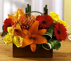 Arrangement of gerberas, lilies and roses by Flower Factor, via Flickr