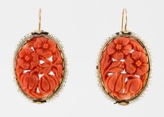 A PAIR OF ANTIQUE GOLD AND CARVED CORAL EARRINGS WITH SEED PEARLS