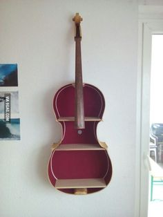 I made a shelf out of an broken cello. What do you think?