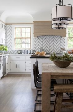 Herringbone tile backsplash in a modern farmhouse kitchen