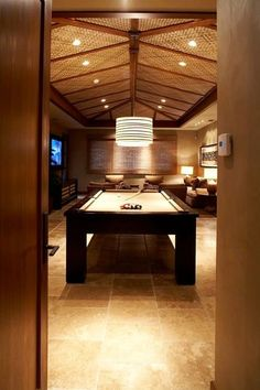 The earthy, natural woven ceiling gives this billiard room a tropical feel. | 10 stunning billiard rooms BilliardFactory.com