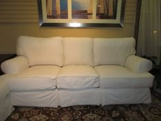 "Price: $849.99 | Item #: 41585  White slip covered sofa. Not oversized, not too small. This is a nice, simple look. At this time, we do have the matching loveseat. Perfect set for a coastal style home.Measurements are 90"" long x 36"" deep x 36"" high..."