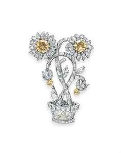 A COLORED DIAMOND AND DIAMOND FLOWER BROOCH  l Christie's Magnificent Jewels - Sale # 2736 - 15th of October 2013 at Rockefeller Plaza, New York. Click to register for online bidding!