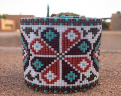 This Danube Folk Birds Bead Loom bracelet was inspired by my love for ancient peasant embroidery patterns. It is my interpretation of a pattern that was found in the Danube region. As with all my pieces, Ive created it on a bead loom with great care and attention to detail. IMPORTANT NOTE: This bracelet measures approximately 7 long. Please measure your wrist carefully before order placement, to ensure a proper fit. If 7 is not the correct size for you, please contact me for options.  The…