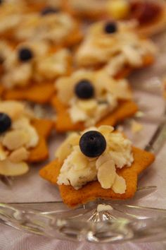 Gingersnaps and gorgonzola canapees with blueberries, almonds and honey. Perfect for using up leftovers after Christmas!