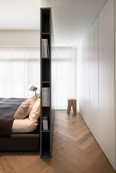 Living ideas bedroom - use the space behind the bed- Wohnideen Schlafzimmer – den Platz hinterm Bett verwerten small modern bedroom with gray partition as bookshelf, built-in wardrobe white, parquet floor and white blinds - Bedroom Wardrobe, Home Bedroom, Bedroom Ideas, Bedroom Decor, Wardrobe Wall, Wardrobe Storage, Library Bedroom, Bedroom Divider, Room Dividers