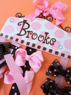 Hair bow holder.  Mod podge paper with vinyl lettering name.NEED for a little girl!