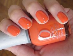 orly - truly tangerine ---- I have Arizona by Zoya but it wears poorly for me & i want a similar orange. Orange is surprisingly classic looking on the nail, I think.