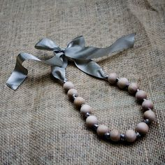 Wooden beads on ribbon for teething necklace! What a great idea!