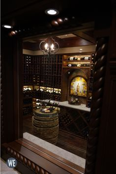 View from an indoor window of a customized reclaimed wine barrel in the center of a fully stocked wine cellar. Wine Cellar Racks, Wine Rack, Wine Cellar Design, Wine Collection, Wine Storage, Design Consultant, Basements, Wood Species, Bella