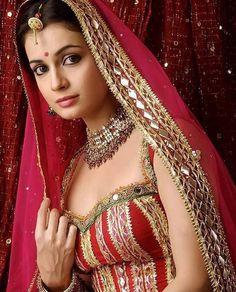 Wearing nude saree red of mirza pic diya