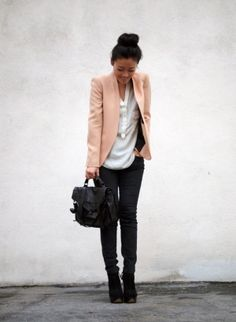 Blush pink blazer, white shirt, black skinny jeans, and black lace-up ankle booties.