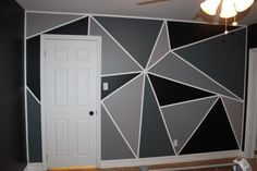 For a feature wall, Shay wanted something geometric. I did some research and ended up coming up with a triangle design for his geometric feature wall. How to Paint a Feature Wall: Prep your walls (… Home Wall Painting, Creative Wall Painting, Creative Walls, Tape Painting, Painted Feature Wall, Feature Wall Bedroom, Feature Walls, Geometric Wall Paint, Geometric Shapes