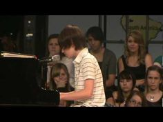 Greyson Chance Singing Paparazzi. This video made him a wonderful little star. :)