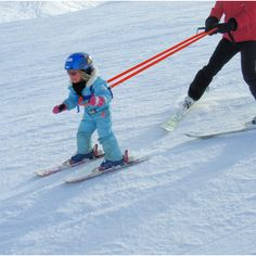 The Nippergrip kids ski harness has is a grab handle at the front and back making it ideal for lifting children on and off of ski lifts as well as hauling them up off the snow. Once you are both off and moving on the slopes a rein helps to both keep your little ones speed under control or give them a bit more security and confidence if they are more nervous skiiers.