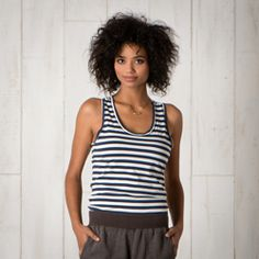 Organic cotton and modal.  Flattering fit, but you need a criss cross bra.
