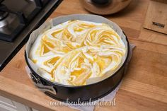 Yoghurttaart met mango en witte chocolade