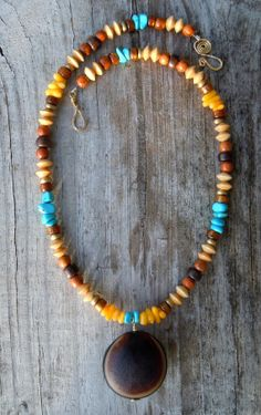 Turquoise and Coral Big Mucuna Seabean by TheEclecticOcean on Etsy, $47.50