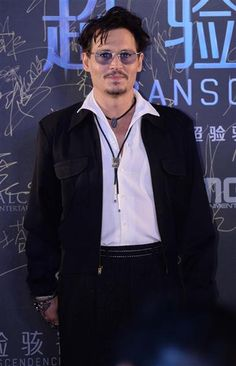 "Johnny Depp arrives at the premiere of ""Transcendence"" at the Grand Hyatt Hotel in Beijing on March 31, 2014"