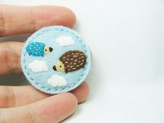 Meeting by chance felt brooch by hanaletters, via Flickr