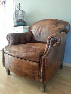 Comfy- soft supple chair tempts you to sink down into the comfort of its rich worn leather