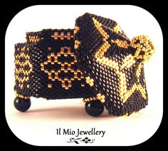 Designed and made by me at Il Mio Jewellery. Black and gold