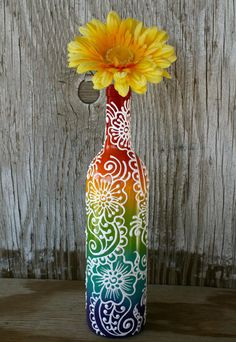 Hand painted bottle with yellow flower.