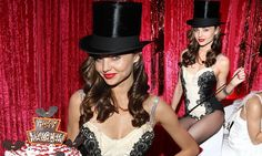 Whipped into shape! Miranda Kerr steals the show in revealing basque as risqué ring master
