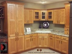 Toffee cabinets black granite sandy brick tile for Kitchen cabinets you put together
