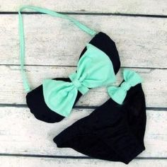 Love the bow placements on this swim suit. Totes adorbs!