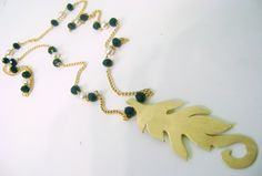 Leaf made of brass,with green crystals and white glass beads