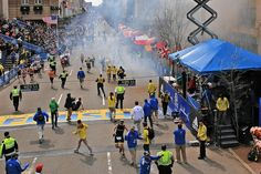 Boston Globe/Getty Images Runners scatter after two explosions Monday near the finish line of the Boston Marathon set off confusion and panic. The blasts killed two people and injured scores of others, Boston police said Boston Marathon 2013, Boston Marathon Bombing, Boston Strong, Explosions, Confusion, Wall Street, Scores, Runners, Police