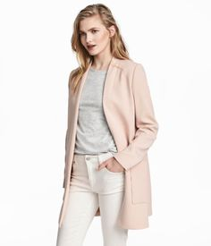 Powder pink. Long, straight-cut jacket in woven fabric with patch pockets and no lapels. Lined.
