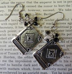 Big Book Earrings in Black. Would look nice to wear at a book signing or something...