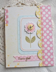 handcrafted card with pastel patterned papers ... luv the how the orange thread makes the machine stitching stand out ...