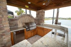 Outdoor kitchen on the water by Da Vinci Cabinetry in Naples, FL