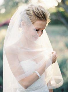 Short veil with an opaque white liner: http://www.stylemepretty.com/2014/12/04/intimate-summer-wedding-at-san-ysidro-ranch/ | Photography: Kurt Boomer - http://kurtboomer.com/