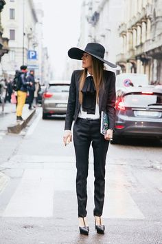 Anna Dello Russo - A wide brimmed hat balances out the lean silhouette of this Saint Laurent tux.