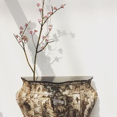 Commode in birch bark marquetry with encrusted crystals and a bronze cast branch with porcelain magnolia flowers @birchbarkfurniture @salonrevelations it's official I'm 😍 #salonrevelations #woodmarquetry #pieceunique #oneofakind #birchbark #interiordesign #interiordecorator #instainspiration #instainspo
